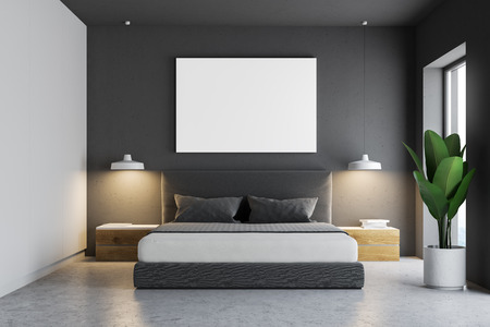 Gray bedroom interior with a concrete floor, a master bed and a horizontal poster hanging above it. 3d rendering mock up Stock Photo