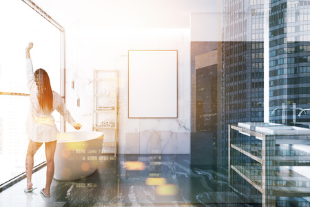 Woman in a loft white marble luxury bathroom interior with a black marble floor, a white bathtub, a double vessel sink and a vertical frame mock up poster. 3d rendering toned image double exposure