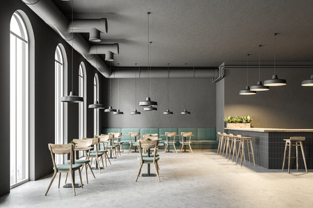 Industrial style cafe interior with dark gray walls, a concrete floor, arched windows and wooden tables with chairs. Green sofas. 3d rendering mock up