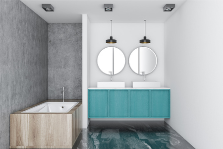 White luxury bathroom interior with a marble floor, a blue double vessel sink and two round mirrors hanging above it. A wooden bathtub. 3d rendering mock up