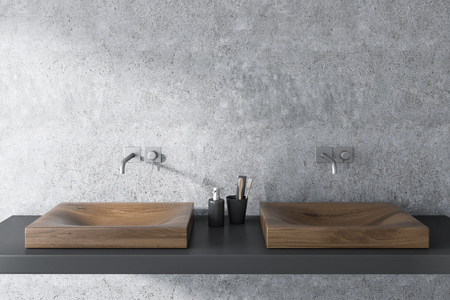 Close up of a wooden double sink standing on a gray shelf in a concrete wall bathroom interior. 3d rendering mock up Stock Photo