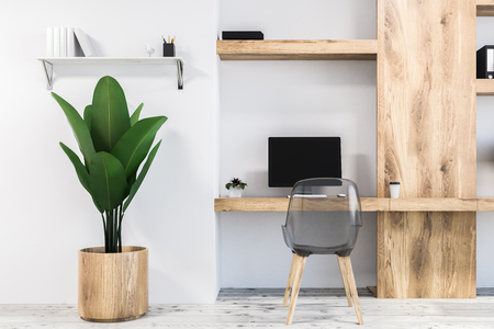 White home office work space in a neat room with a concrete floor and a white computer desk. Shelves and a potted plant. 3d rendering mock up