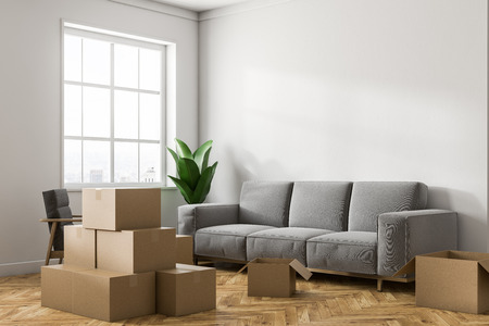 Empty white room corner with white walls, a wooden floor, a large window and stacks of closed cardboard boxes. A gray sofa. Concept of moving in. 3d rendering mock up Banque d'images - 106225718