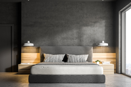 Interior of a modern bedroom with gray walls, a concrete floor, a double bed and two bedside tables. 3d rendering mock up Standard-Bild