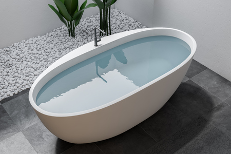 Elegant white bathtub filled with water standing in a luxury bathroom interior with white walls, a tiled floor and plants. 3d rendering top view