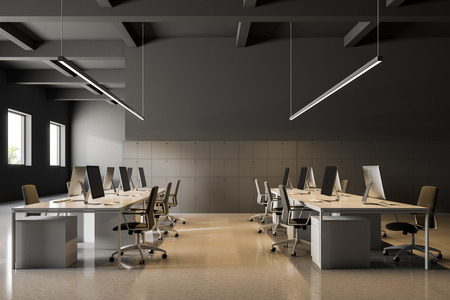 Industrial style office interior with gray walls, a white glossy floor and rows of computer tables standing along white lockers. Side view Business and finance. 3d rendering mock up Фото со стока
