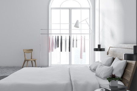 Scandinavian style bedroom with white walls, a tiled floor, a clothes rack, and a master bed with bedside tables. Side view 3d rendering mock up