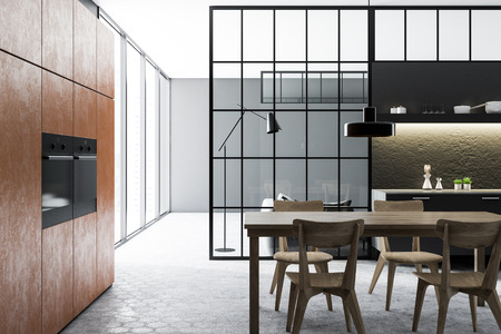 Black and concrete wall kitchen and dining room interior with a tiled floor, brown closets with built in appliances, black countertops and a wooden table with chairs. 3d rendering mock up