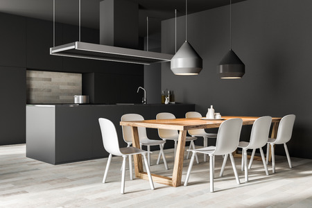 Gray wall kitchen and dining room corner with a wooden floor, grey closets and countertops and an island with a sink. Table with chairs. 3d rendering Stock Photo