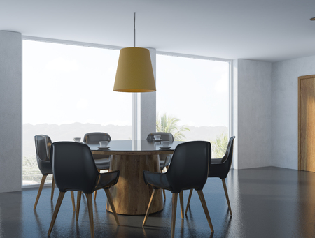 Cozy modern dining room corner with white walls, a black floor, a round table with black and wooden chairs and a panoramic window with a tropical view. 3d rendering