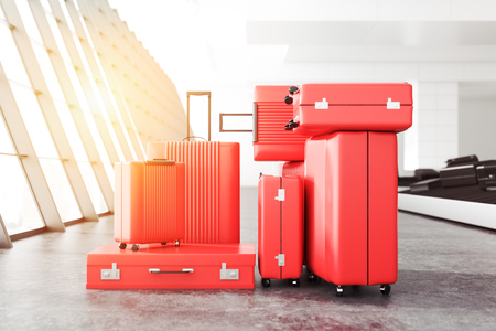 Stack of red suitcases of all sizes and forms standing on an airport floor near a large window. Concept of travelling for work and pleasure. 3d rendering mock up toned image