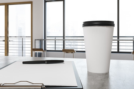 Mock up white and black cup of takeaway coffee standing on a panoramic windows cafe table next to a clipboard with a white shit of paper. 3d rendering