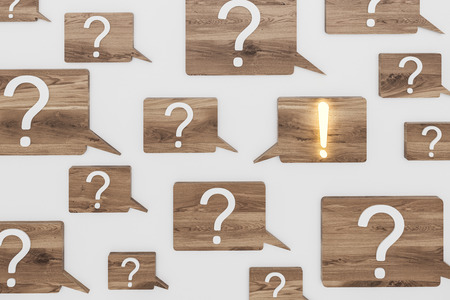White question and exclamation marks on wooden speech bubbles over gray background. Shining exclamation mark. FAQ concept and looking for an answer. 3d rendering Фото со стока
