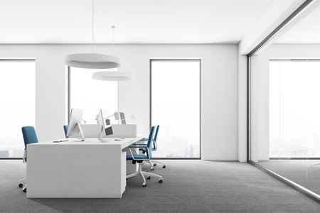 Open space office with white walls, gray carpet on the floor, loft windows and computer tables with blue chairs. Side view. 3d rendering mock up