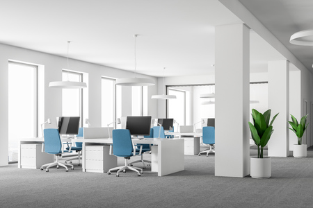 Side view of open space office interior with white walls, carpet on the floor, loft windows and rows of computer tables with blue chairs. 3d rendering mock up
