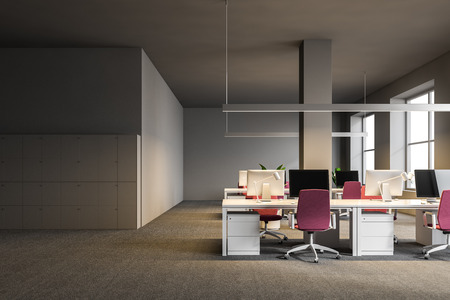 Open plan office interior with gray walls, a carpet on the floor, white computer tables with pink chairs and lockers. 3d rendering mock up