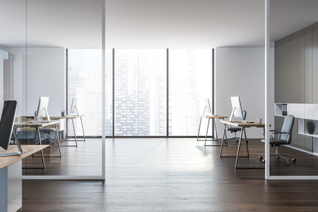 Side view of modern manager office interior with a wooden floor, white walls, stylish computer tables and a panoramic cityscape window. 3d rendering mock up
