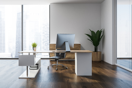 Modern manager office interior with a wooden floor, white walls, a stylish computer table and a plant in pot. 3d rendering mock up