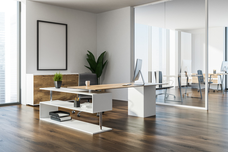 Modern manager office corner with a wooden floor, white walls, a stylish computer table and a mock up poster frame. 3d rendering