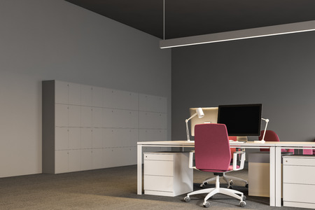 Corner of open plan office with gray walls, a carpet on the floor, white computer tables with pink chairs and lockers. Front view. 3d rendering mock up