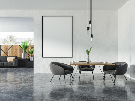 Interior of studio apartment with a square table with gray armchairs and sofa with cushions. Mock up vertical poster fram on the wall 3d rendering