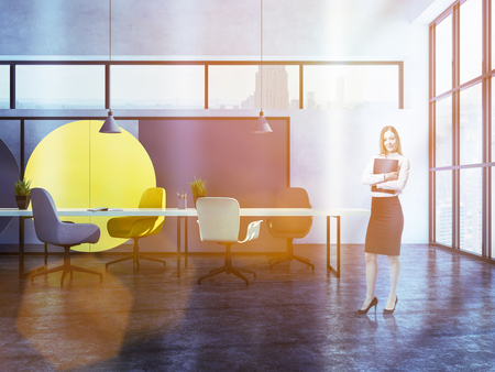 Blonde businesswoman standing in geometric wall pattern boardroom interior with concrete floor, narrow and panoramic windows, and long table with chairs. 3d rendering copy space toned image 스톡 콘텐츠
