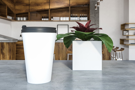 Mock up white and black cup of takeaway coffee standing on a stylish cafe table next to a plant in a white pot. 3d rendering