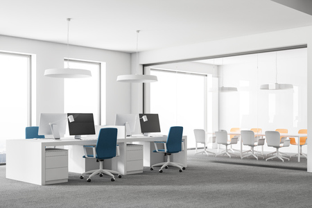 Side view of stylish open space office interior with white walls, carpet on the floor, loft windows and rows of computer tables with blue chairs. 3d rendering mock up Stock Photo