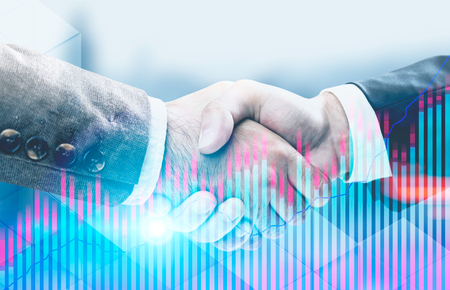 Close up of two businessmen shaking hands. Forex style blue and red bar charts and graphs over a blurred city background. Concept of sealing a deal. Toned image double exposure mock up Stock Photo