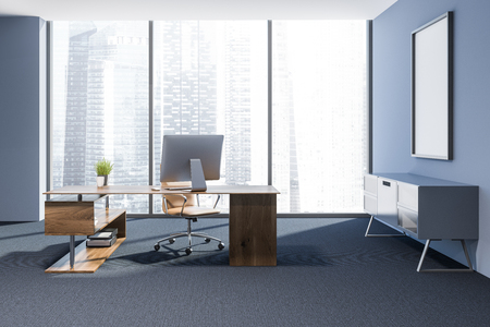 Modern manager office interior with a carpet on floor, blue walls, a stylish computer table and a mock up poster frame. 3d rendering