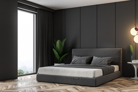 Corner of luxury loft bedroom with grey panel walls, a wooden floor and a double bed with gray cover. 3d rendering copy space