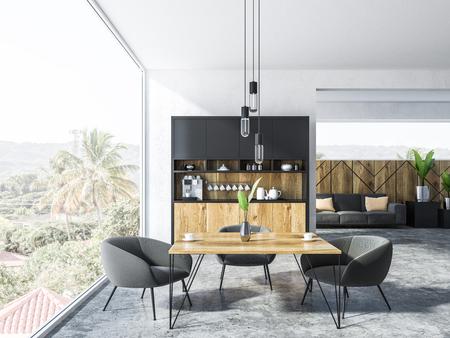 Interior del apartamento estudio con rincón de cocina, una mesa cuadrada con sillones grises y un sofá con cojines. Paisaje de vista tropical en la ventana. Representación 3d Foto de archivo