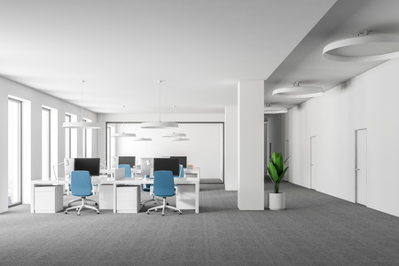 Open space office interior with white walls, carpet on the floor, loft windows and rows of computer tables with blue chairs. 3d rendering mock up