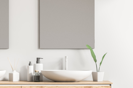 Close up of white sink on a wooden vanity unit in a white wall bathroom with a mirror and liquid soap. Relaxation and self care concept. 3d rendering Фото со стока