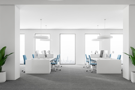 Open space office with white walls, gray carpet on the floor, loft windows and rows of computer tables with blue chairs. Side view 3d rendering mock up Stock Photo