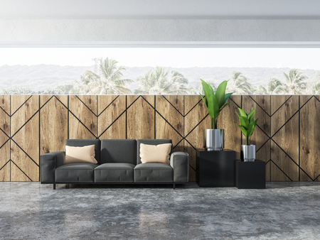Wooden wall pattern living room interior with a gray sofa standing on a concrete floor and large silver flower pots with plants. Tropical view scenery in the windows. 3d rendering