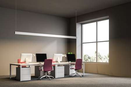 Side view of open plan office with gray walls, a carpet on the floor, and white computer tables with pink chairs. 3d rendering mock up