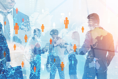 Diverse business team members walking and standing over cityscape background and global people network foreground Toned image double exposure mock up Stock Photo