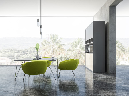 Interior of dining room with concrete walls and floor, panoramic window with tropical view, and a square table with green armchairs. 3d rendering copy space