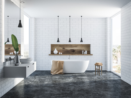 White brick bathroom interior with a concrete floor, a white bathtub, a round sink, several ceiling lamps and a wooden shelf with candles. 3d rendering Banco de Imagens