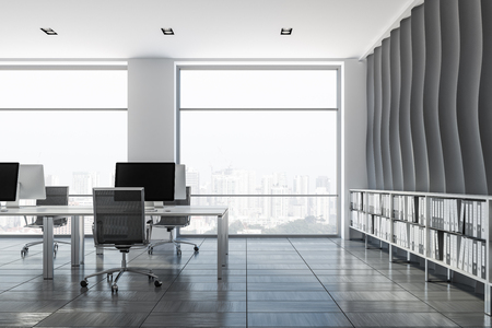 Open plan office interior with wave pattern wall, wooden tiles floor, rows of computer tables with metallic chairs and shelves with folders in them. 3d rendering Stock Photo