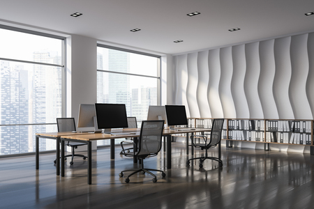 Open plan office corner with wave pattern wall, wooden floor, rows of computer tables with chairs and shelves with folders in them. 3d rendering Stock Photo