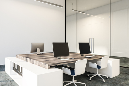 Black computer screens standing on wooden tables in minimalistic white office with concrete floor and loft windows. Side view 3d rendering copy space Stock Photo