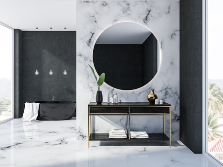 White marble and black bathroom interior with a black bathtub, a round mirror above a black vanity unit with creams and candles and, several ceiling lamps. 3d rendering Stock Photo - 109249501