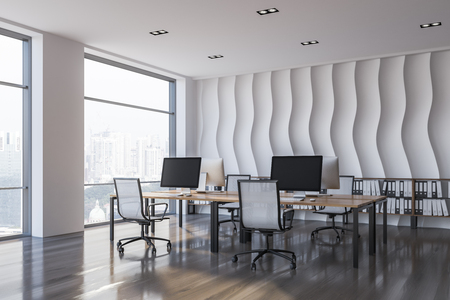 Corner of open plan office with wave pattern wall, wooden floor, rows of computer tables with chairs and shelves with folders in them. 3d rendering