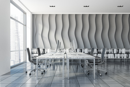 Open plan office interior with wave pattern wall, wooden tiles floor, rows of computer tables with metallic chairs and shelves with folders in them. Side view 3d rendering copy space