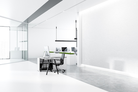 Minimalistic office interior with white walls, concrete floor with rows of white tables with black computer screens and panoramic windows. Side view of mock up wall and small desk. 3d rendering