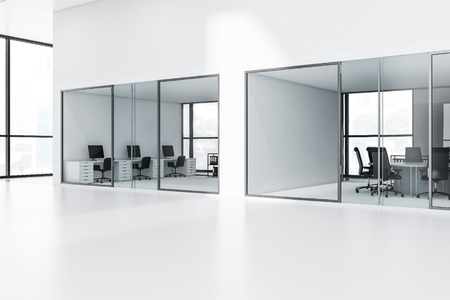 Lobby of a modern company with white and glass walls, white computer desks with black chairs and a conference room. 3d rendering copy space Stock Photo