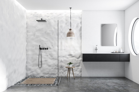 White tile and crude wall bathroom interior with black sink, vertical mirror and glass wall shower. Concrete and pebble floor. 3d rendering