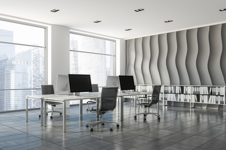 Open plan office corner with wave pattern wall, wooden tiles floor, rows of computer tables with metallic chairs and shelves with folders in them. 3d rendering Stock Photo